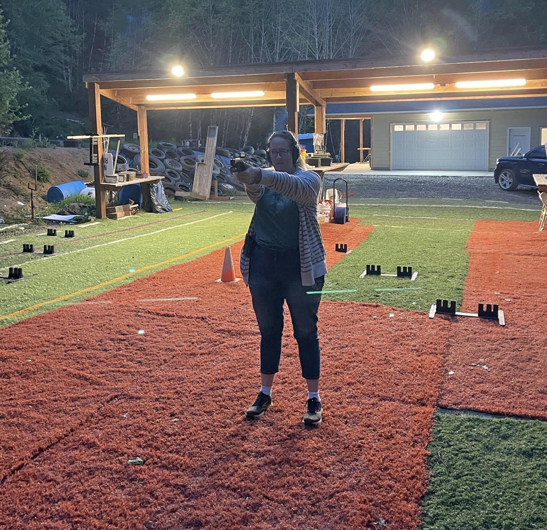 woman shooting practice